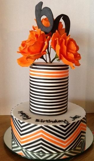 60th Birthday Cake project on Craftsy.com  Orange & black stripes and chevrons with orange roses - I actually love the mirrored cake plate, too!