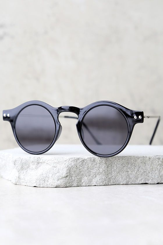 The Spitfire Nexus Black Round Sunglasses are the next big trend taking over! Thin, round frames have a shiny finish and high, curving bridge with notched detail. Flat, black lenses. UV 400.