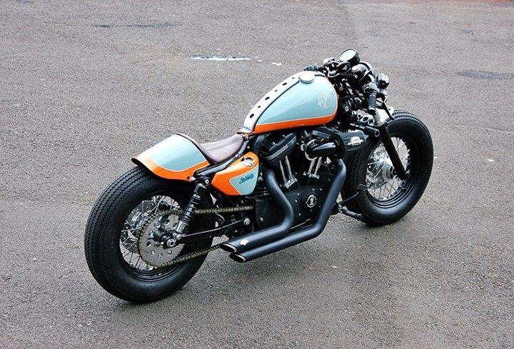 Harley Davidson Sportster 1200 (48) new-wave cafe racer : Studio Motor : Tank Strap, Fast Back Seat, vintage style tires Roland Sands speedo, Vance & Hines short shots