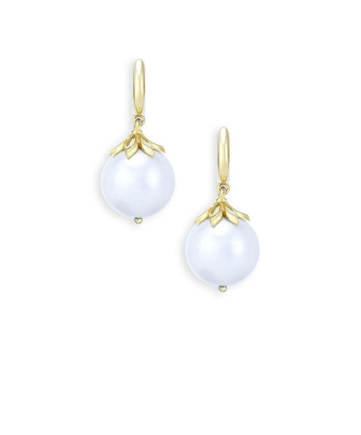 Fresh water pearl and yellow gold drop earrings.