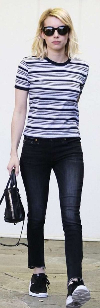 Who made Emma Roberts' black sunglasses, white stripe tee, skinny gray jeans, sneakers, and handbag