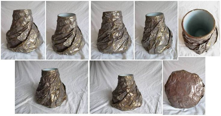 Vaso: bottiglia tagliata, rivestita con imballaggio a bolle e carta a drappeggio, color marrone con velatura bianca e bronzo. Materiale: carta di riciclo, bottiglia di vetro di riciclo, imaballaggio bolle di riciclo. Misura altezza: 20cm