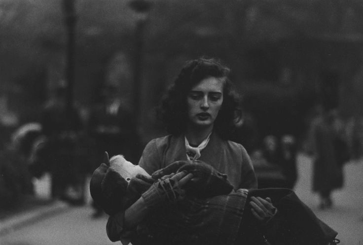 Woman carrying a child in Central Park, 1956 Diane Arbus | via TIME