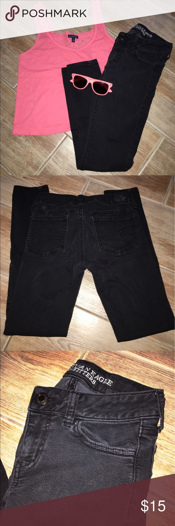 American Eagle Jegging Skinny Jeans Comfy and stretchy jegging jeans from American Eagle. They're black but slightly faded, still in great condition! Size 0 short. The tank in the photo is also for sale in my closet. American Eagle Outfitters Jeans Skinny