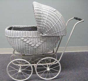 Vintage white wicker baby carriage