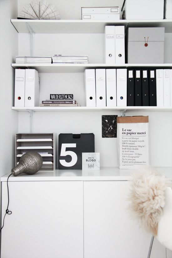 I like the gray, black and white color combination. Love the organization file boxes!