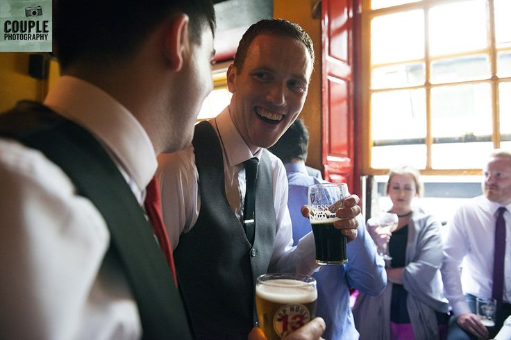 groom enjoys a pint with the lads. Real Wedding by Couple Photography