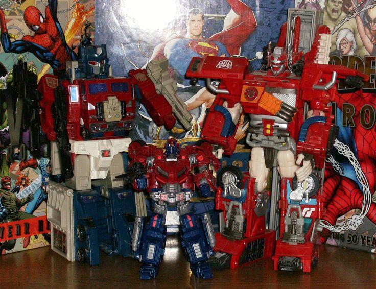L to R: Powermaster Optimus Prime, Cybertron Optimus Prime, Fire Convoy Optimus Prime.
