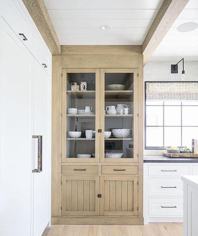 Beautiful wooden corner cabinet | Kelly Nutt Design Photo by: Ryan Garvin