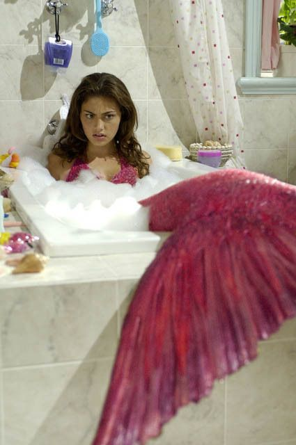 Phoebe Tonkin as Cleo in H2O: Just Add Water. (She is suppose to have an orange tail, but this picture is pink)