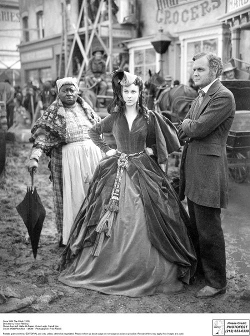 """Gone with the Wind"".  Atlanta rises from the ashes of war. Hattie McDaniel and Vivien Leigh shown left and center. Each won Oscars for their roles in GWTW."