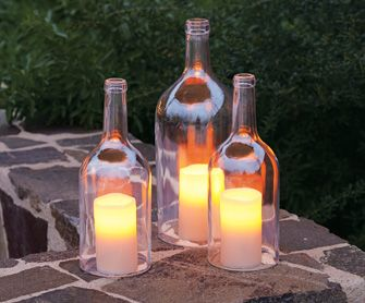 cut bottoms off wine bottles to use for candle covers; looks cool and keeps the wind from blowing them out.: Candles Lights, Bottle Hurricane, Bottle Candles, Wine Bottles, Glasses Bottle, Outdoor Lights, Winebottl, Candles Gardens Wedding, Candles Covers