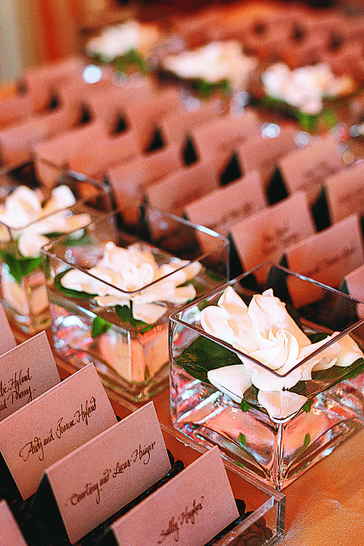 Each table was named after a restaurant where something meaningful had occurred for the couple, such as their first date. Gardenias — the inspiration for the wedding's decor — also accented the escort-card table.