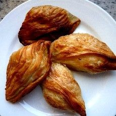 Pastizzi - a Maltese delicacy, delicious puff pastry filled with seasoned ricotta cheese.