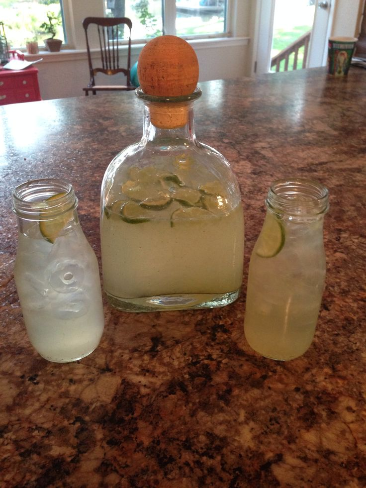 Limeade in repurposed Patron bottle and Starbucks bottles