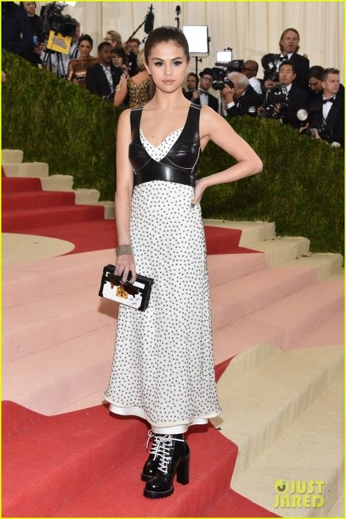 f90555cc4d Selena Gomez at Met gala 2016   Selena opted for a Louis Vuitton outfit  with matching laced-up boots and clutch. I wasn t really sure about the  dress at ...
