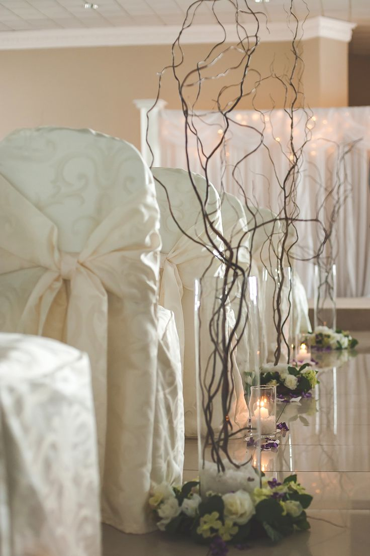 Tall glass vases with branches and floral bases #WeddingDecor