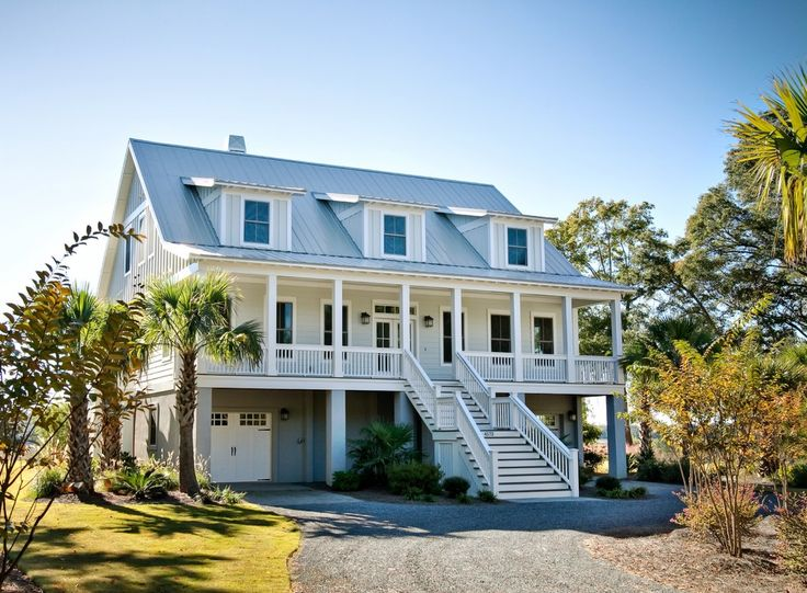 Cool Raised Ranch vogue Charleston Beach Style Exterior Innovative Designs with board and batten carriage doors covered entry dormers gable roof gravel drive light gray