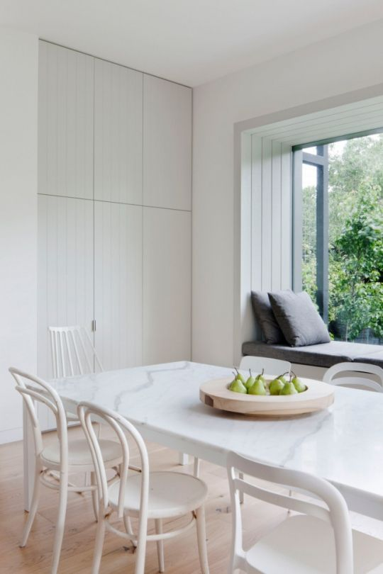 Clean bright and white kitchen space. Two loves for me here - the tongue and groove cupboards and the built in window seat  by Robson Rak Architects and Made by Cohen.