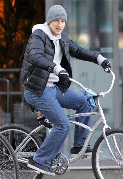 It's a good idea to bundle up like Owen Wilson when going out for a bike ride in the cool winter weather.