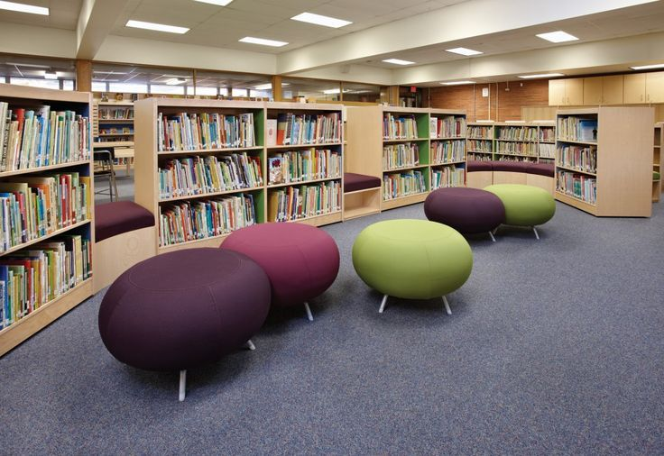 ColorScape shelving and furniture pairs well with Allermuir Pebble stools to create a unique library landscape in the library at Washington Elementary School, IL. | DEMCO Interiors