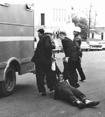 [Alabama Dept. Public Safety photo] SNCC leader Jim Forman is arrested and dragged away. This involves how the SNCC changed to violent instead of non violent.