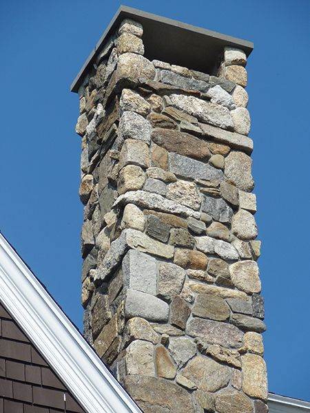 Rustic Chimney with a mix of Boston Blend Round, Ledgestone, and Square & Rectangular Thin Stone Veneer
