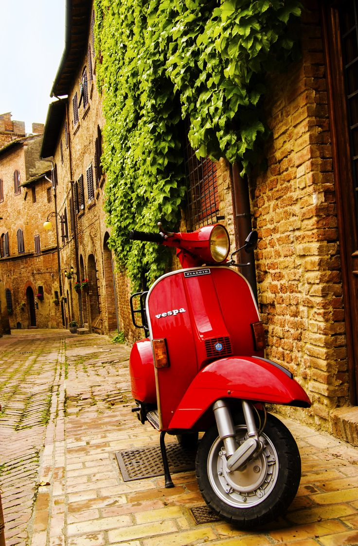 Red Vespa in Italy is in my future.