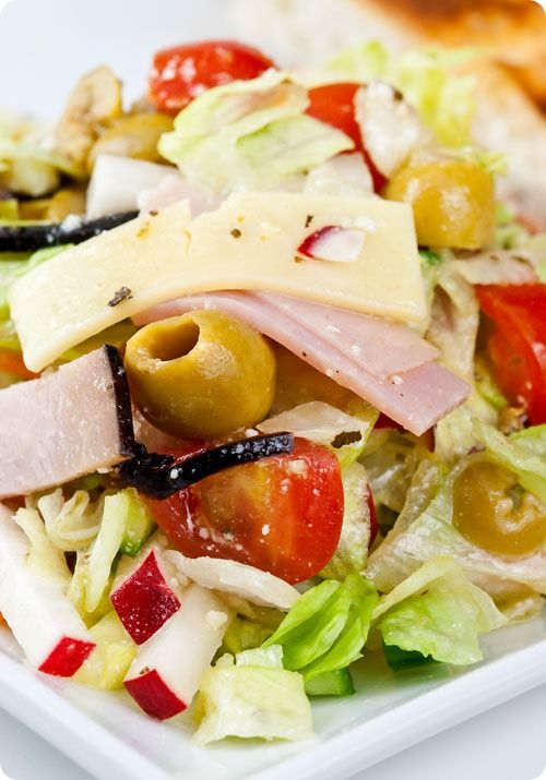 The Columbia 1905 Salad - Loaded with ham, Swiss cheese, olives, and tomatoes, this delicious salad from Florida's famous Cuban restaurant the Columbia from Sticky, Gooey, Creamy, Chewy | A Blog About Food with a Little Life Stirred In