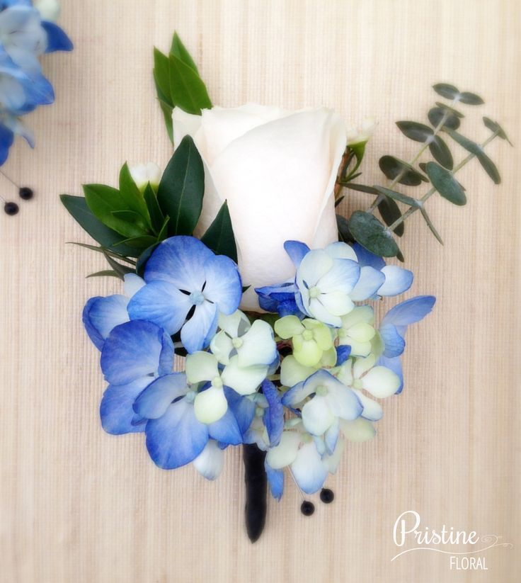 Boutonniere designed with Ivory Rose, Blue Hydrangea, finished with Eucalyptus & Myrtle