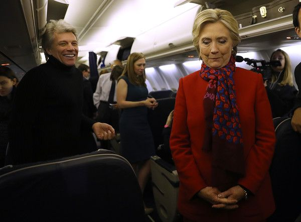 Jon Bon Jovi Photos Photos - Democratic presidential nominee former Secretary of State Hillary Clinton (R) stands with musician Jon Bon Jovi aboard her campaign plane at Philadelphia International Airport on November 7, 2016 in Philadelphia Pennsylvania. With one day to go until election day, Hillary Clinton is campaigning in Pennsylvania, Michigan and North Carolina. - Hillary Clinton Campaigns Across US One Day Ahead Of Presidential Election