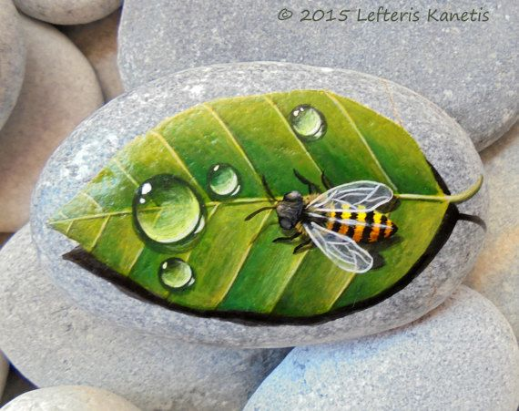 Hand Painted Stone Bee On A Leaf ! Is Painted With High Quality Acrylic Paints And Finished With Glossy Varnish Protection.