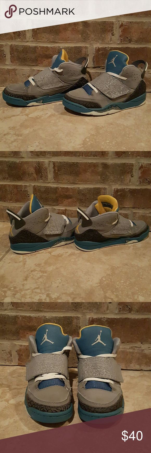 Gently used Michael Jordan boys shoes Great pair of gray, baby blue, & yellow size 2.5 boys shoes Michael Jordan  Shoes Sneakers