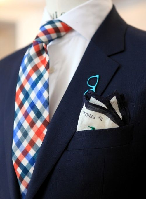 This tie is amazing, though I would have dropped the glasses pin and paired this tie with an orange pocket square to really make the colors pop - RT