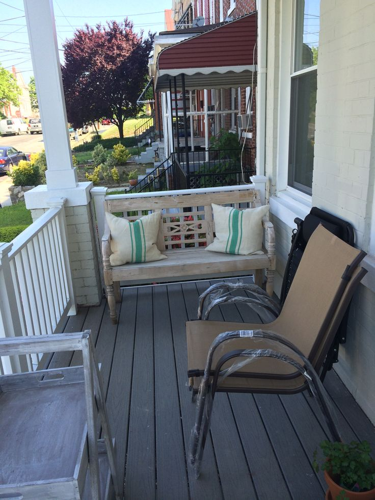 View of the porch now, looking like a moving sale. Justin got a few Home Depot chairs as extras. Meh