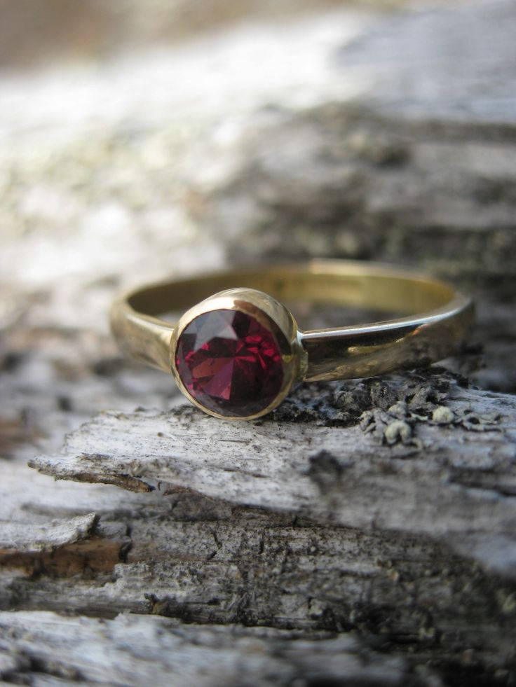 Hand cut Garnet & Gold ring. Made from my dad's engagement ring from 1970's
