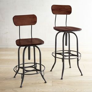 The Industrial Revolution lives on in our high-design architectural pieces inspired by vintage factory work stools. Antiqued wrought iron and distressed mango wood join forces for a lofty cause: To build a seat that swivels and works hard wherever it's needed, from kitchen to dining room to home office to atelier. And that's still revolutionary.