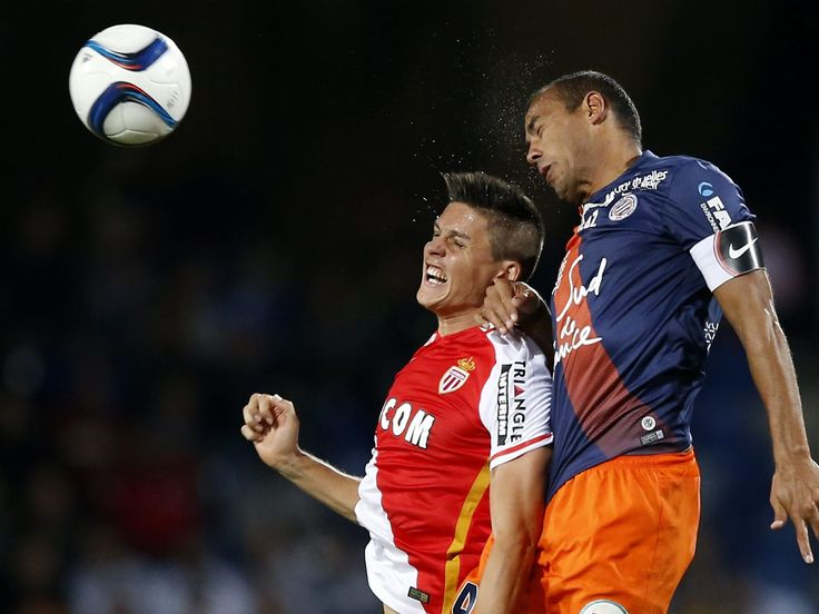 Guido Garrillo of ASM Monaco, left, vies for the ball with Vitorino Hilton of Montpellier HSC during their French League 1 soccer match in Montpellier, France.  Guillaume Horcajuelo, EPA