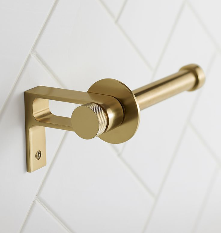 Inspired by the simple lines and functionality of Northwest Modern architect John Yeon's cabinet and door hardware, our West Slope hardware collection was designed in-house and offers sturdy dimensions, unadorned geometry, and flat circle finials.  * Brass * Mounting hardware included * Imported
