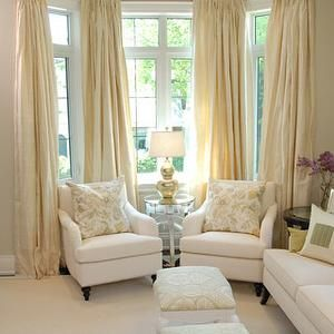 Seating in your living room bay window...but not in white...good window treatments to compliment.
