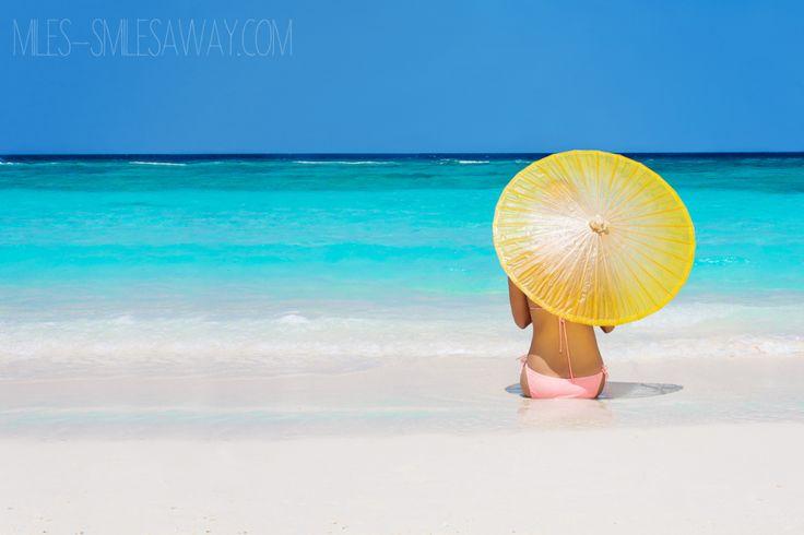 me at the beach at Cheval Blanc Randelhi in Maldives