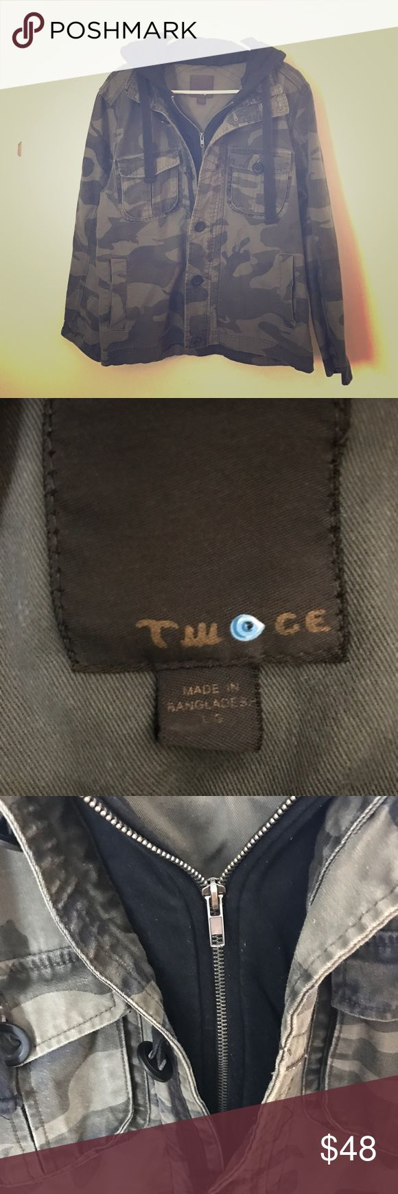 'Twoge' Army Camouflage Jacket with Hoodie This jacket is made by 'Twoge' and has an attached black hoodie inside. There are buttons and pockets. It's very warm and cozy and in good condition. From a non smoking home. Fast 💨 shipping. Jackets & Coats Utility Jackets