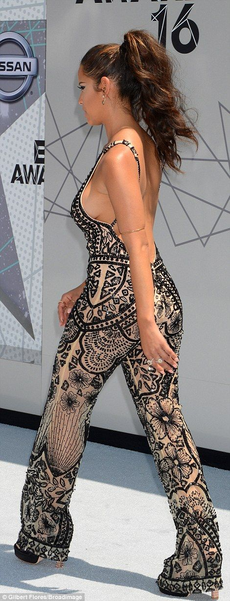 Like a glove: Rocsi Diaz stunned in a sheer jumpsuit with glittery embellishments
