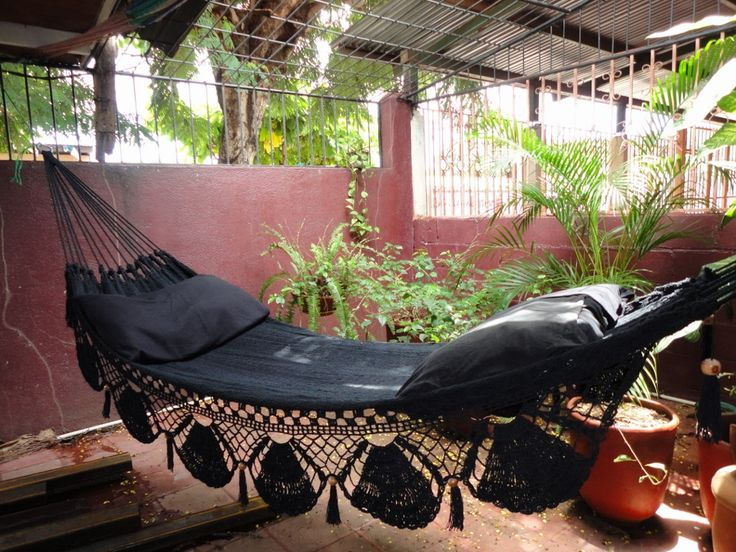 """""""...and one for out back as well""""!   Black Hammock, Hand Woven Natural Cotton with Special Fringe. $61.00, via Etsy."""