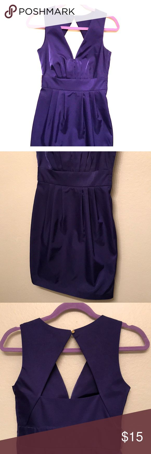 Purple night out dress Purple dress. Not so mini. Passed finger length. Small slit in the back. Side zipper. Belt holes. Semi backless (see photos). Extra buttons attached to inside tag. 100% Polyester. H&M Dresses Mini