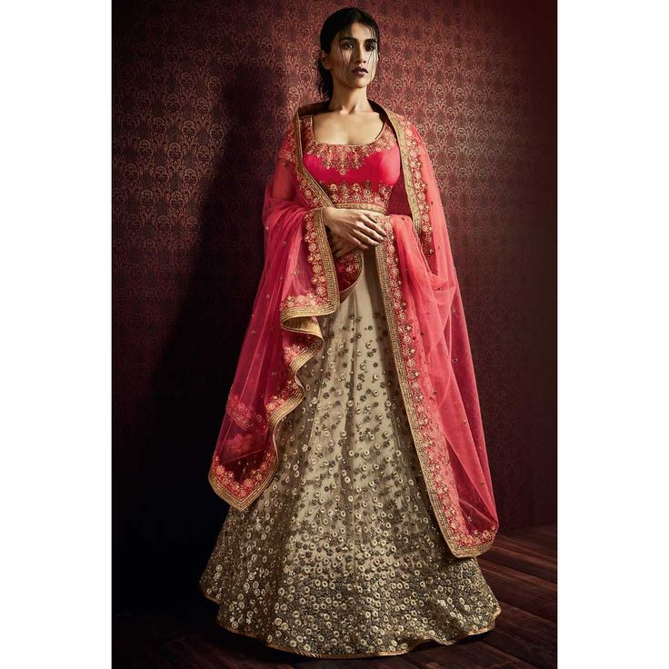 Latest & Stylish Beige Net Lehenga With Silk Choli Beige net semi stitch lehenga with silk choli. This lehenga choli is embellished with embroidered .Product are available in 34,36,38,40 sizes. It is perfect for Wedding Wear.  Andaaz Fashion is the most popular designer wear online ethnic shop brands in BABERGH, UK.  http://images.andaazfashion.co.uk/media/catalog/product/cache/14/image/1200x/a242500c7f4580d5957d22f8b92ad083/d/e/design-no-dmv10103-designer-lehenga-choli-collection-front