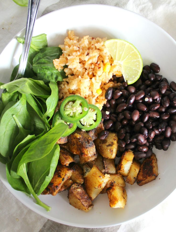 This Mexican Buddha Bowl is a healthy combo of seasoned potatoes, rice, beans and greens   VEGAN + GF   ThisSavoryVegan.com