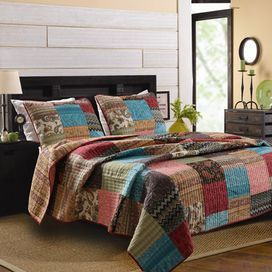 "Brimming with bohemian appeal, this cotton quilt set showcases a patchwork design featuring paisley, chevron, and stripe patterns.  Product: Twin: 1 Quilt and 1 standard shamQueen: 1 Quilt and 2 standard shamsKing: 1 Quilt and 2 king shamsConstruction Material: CottonColor: MultiFeatures:  Pre-washed and pre-shrunkOversized for better mattress coverageMachine-quilted for durability Fabric-bound edgesDimensions: Standard Sham: 20"" x 26""Twin Quilt: 68"" x 88""Queen Quilt: 90"" x 90""King Sham: ..."