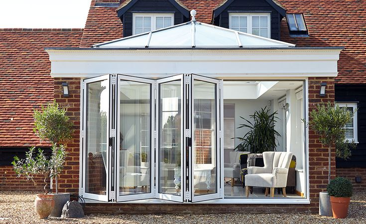 A beautiful orangery with Bi-folding doors, really brings the outside in! For your free quote on bi-folding doors visit www.csggroup.co.uk