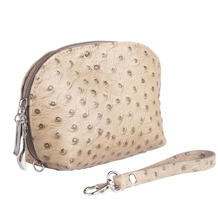 Here's a must-have for every woman this season and beyond! The Tilly Ostrich embossed leather purse can also double as a stylish make up case. Pictured here in Taupe, this little number is just divine and will match with any outfit.